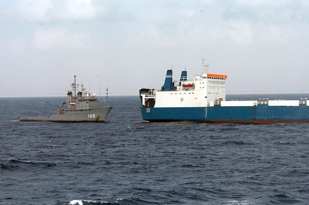 The U.S. Navy fleet ocean tug USNS Catawba (T-ATF 168) provides fuel and fresh water to M/v Faina following its release by Somali pirates in 2009. (U.S. Navy photo by Mass Communication Specialist 1st Class Michael R. McCormick/Released)