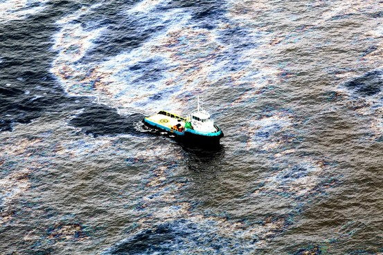 A vessel works to clean up oil from last months Frade Oil Spill offshore Brazil