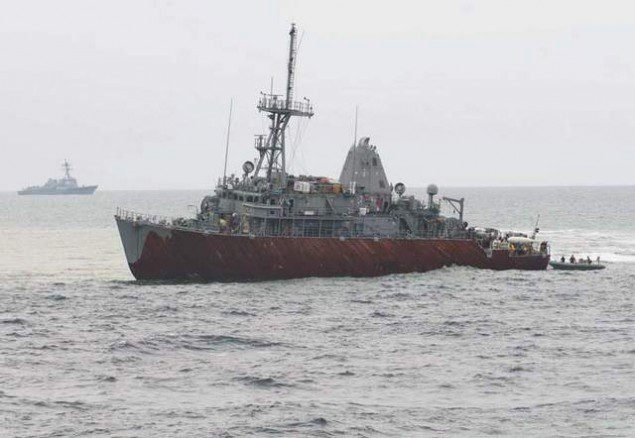 USS Guardian grounded on