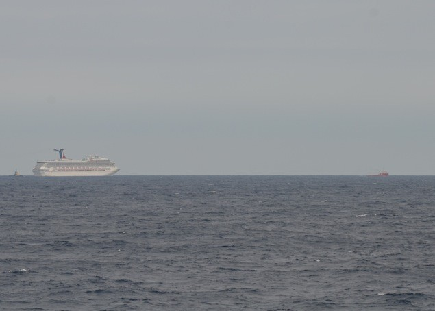 GULF OF MEXICO - The Carnival Cruise Ship Triumph is towed by the tug vessels Pioneer and Roland Falgout toward Mobile, Ala., Feb. 13, 2013. U.S. Coast Guard photo