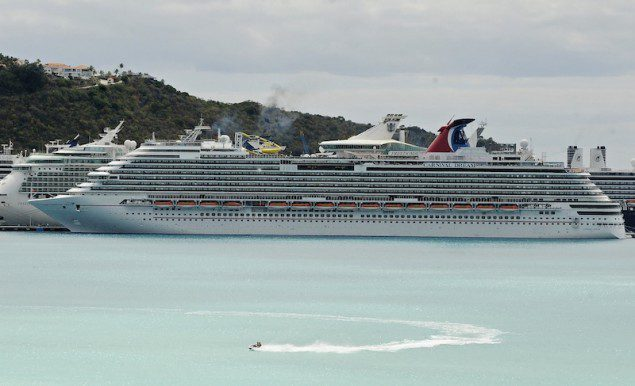 A view of the Carnival Dream cruise ship moored at the A.C. Wathey Cruise Facilities after a diesel generator malfunctioned causing temporary disruptions, in Philipsburg, Sint Maarten, March 14, 2013. A Carnival Cruise Lines ship was stuck at a Caribbean port with equipment trouble on Thursday, a month after another Carnival vessel was disabled by a fire that trapped thousands of passengers at sea for days. Carnival Corp said it was making arrangements to fly the passengers, via charter flights and regularly scheduled flights from the Caribbean island, to Orlando or their final destination.  REUTERS/John Halley (SINT MAARTEN - Tags: DISASTER TRAVEL)