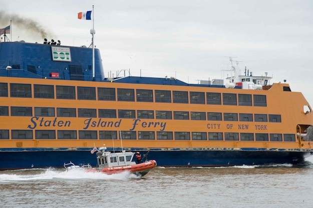 NEW YORK – A Coast Guard 25-foot response boat crew of Station New York performs a safety and security escort of a Staten Island Ferry departing Manhattan, April 17, 2013. US Coast Guard Photo