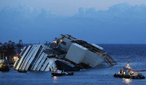 The capsized cruise liner Costa Concordia lies on its side next to Giglio Island September 16, 2013 as the parbuckling operation gets underway. REUTERS/Tony Gentile