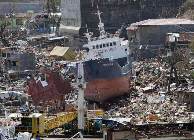 A cargo ship washed ashore is seen four days after super typhoon Haiyan hit Anibong town, Tacloban city, central Philippines November 11, 2013. REUTERS/Romeo Ranoco