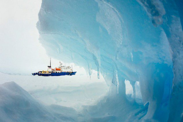 The MV Akademik Shokalskiy is pictured stranded in ice in Antarctica, December 29, 2013. An Antarctic blizzard has halted an Australian icebreaker's bid to reach a Russian ship trapped for a week with 74 people onboard, rescuers said on Monday. REUTERS/Andrew Peacock